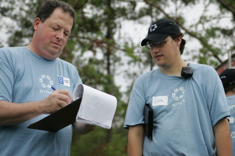 Seth Gardner (pictured on the right) in Hattiesburg, MS after Hurricane Katrina in 2005.