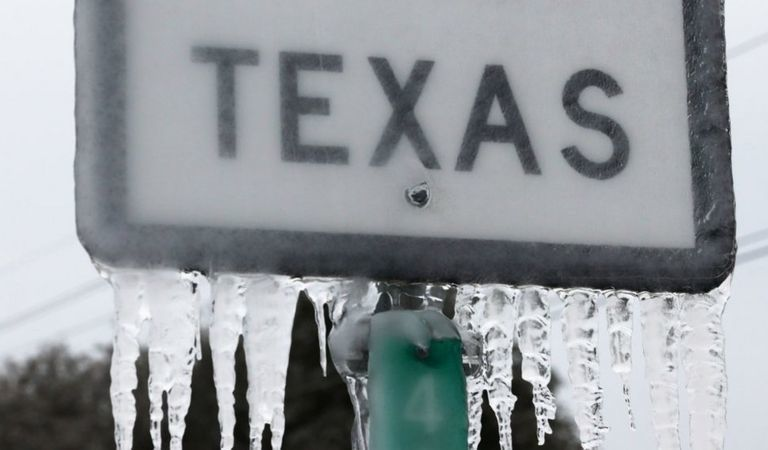 Texas road sign with icicles after Winter Storm Uri