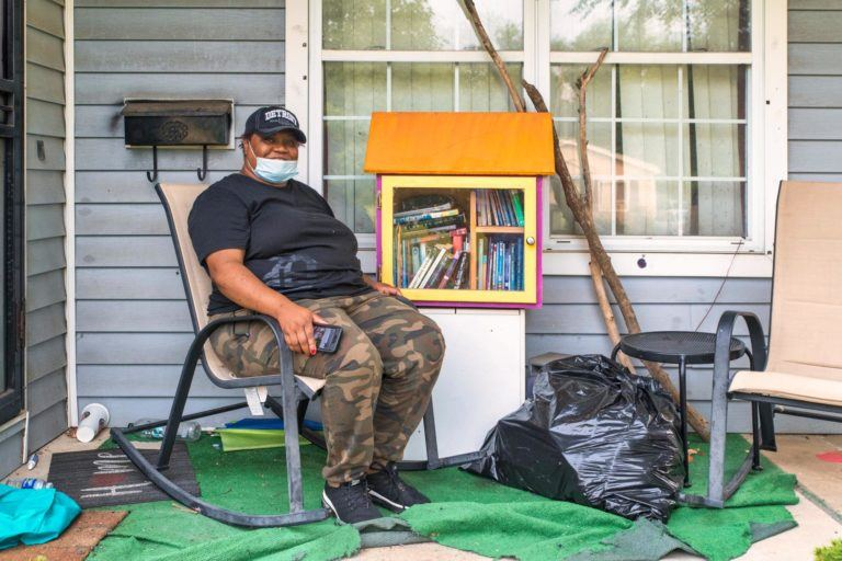 Giving back to those who Give. A homeowner sits on their porch after their home has been cleared of damaged materials following flooding in Detroit, Michigan.