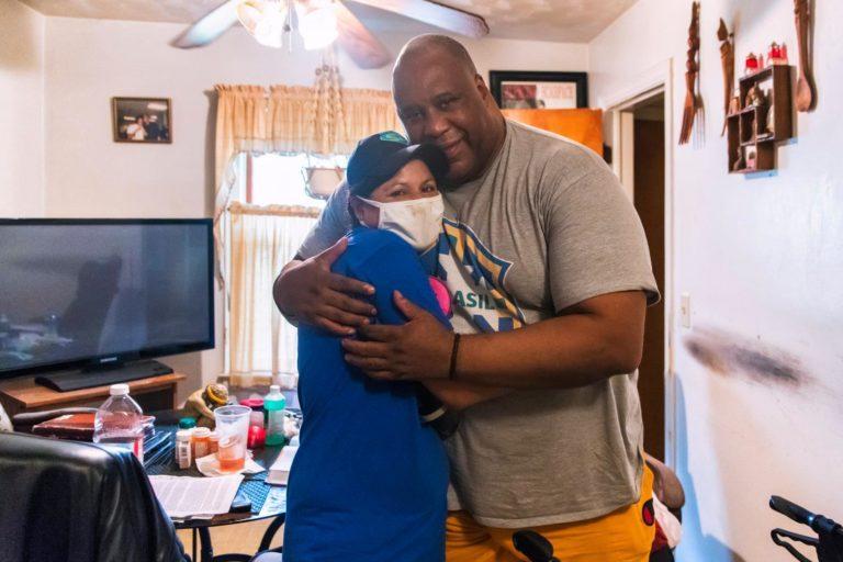 Meeting Mr. Peterson- a NECHAMA volunteer hugs Mr. Peterson